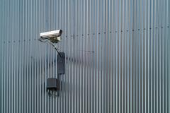 Security camera on a wall Stock Photos