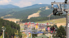 Young Family Climbs On Mountain Lift - stock footage