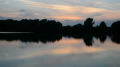 Pond at dusk with duck Stock Footage