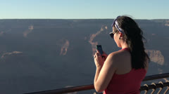 Female taking picture of Grand Canyon Stock Footage
