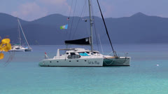 Luxury Catamaran moored in a Bay in the BVI's Stock Footage