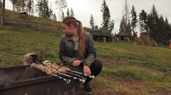 Girl Sits Near Mangal With Dog Stock Footage