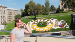 Woman Near Flower Clock - stock footage
