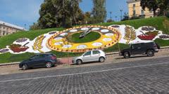 Traffic Near Real Flower Clock Stock Footage