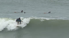 Surfer briefly catches wave. Stock Footage