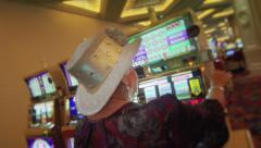Vegas - Woman Playing Slot Machine - stock footage