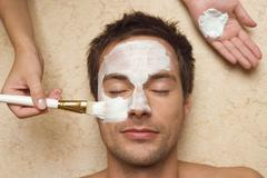 germany, man getting a facial, close-up - stock photo