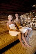 Germany, senior woman and man sitting in sauna Stock Photos