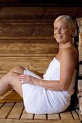 Germany, senior woman in sauna Stock Photos