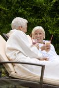Germany, senior couple drinking smoothie in spa Stock Photos