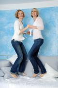 Two women fooling about, portrait - stock photo