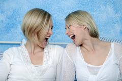 Two blonde women fooling about, portrait Stock Photos