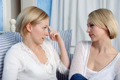 Two blonde women arguing, portrait - stock photo