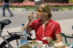 Italy, Trento, Arco, Woman with mountainbike drinking water Stock Photos