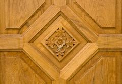wooden ornament on door in flower shape - stock photo