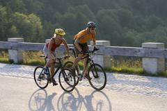 Germany, Bavaria, Sylvenstein, Couple mountain biking Stock Photos