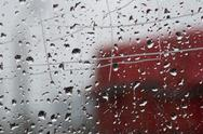 Stock Photo of Raindrops on window pane, close-up