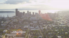 Aerial sun flare cityscape view of Seattle Business Center, USA Stock Footage