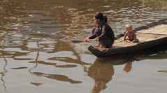 Cambodia river - boat with mom and baby.mp4 Stock Footage