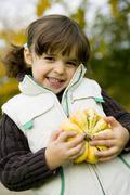 girl (4-5) holding pupmkin, close-up - stock photo