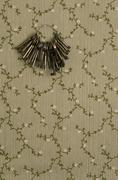 Keys on keyring hanging on wall - stock photo