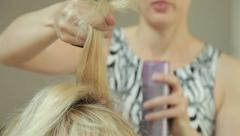 Make-up artist brushing and spraying hair Stock Footage
