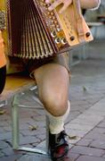 Austria, man playing accordion, low-section - stock photo
