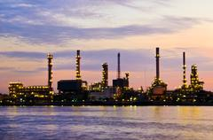 Petroleum oil refinery factory over sunrise Stock Photos