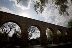Aquaduct morelia mexico backlit Stock Photos