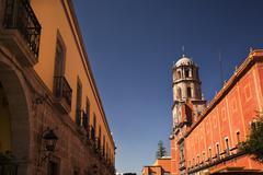 Stock Photo of orange adobe wall san francisco church queretaro mexico