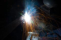 Arc welder with welding sparks Stock Photos