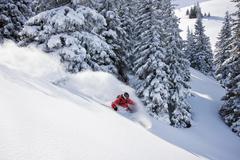 Austria, Tyrol, Kitzbuhel, Pass Thurn, Freeride, Man skiing downhill - stock photo