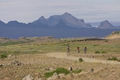 Iceland, Men mountain biking in hilly landscape Stock Photos