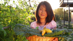 Asian Girl Holding Basket of Organic Vegetables from the Garden Stock Footage