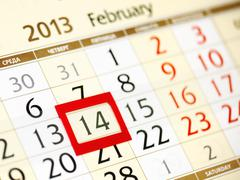 Calendar page with red frame on february 14 2013 Stock Photos