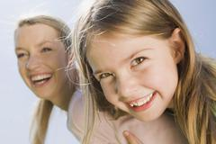 Germany, Bavaria, Munich, Mother and daughter (6-7) portrait, close-up - stock photo