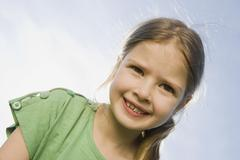 Stock Photo of Germany, Bavaria, Munich, Portrait of a girl (6-7), close-up