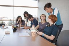 Germany, Leipzig, University students studying and discussing - stock photo