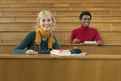 Germany, Leipzig, Students sitting in auditorium, smiling, portrait - stock photo