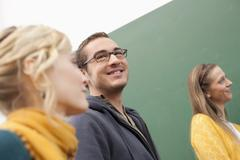 Germany, Leipzig, University students sitting together, smiling - stock photo