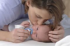 Germany, Bavaria, Munich, Mother kissing newborn (3 weeks), close up Stock Photos