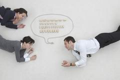 Business people and speech bubble, elevated view - stock photo
