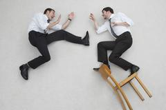 Two businesssmen fighting, side view, elevated view Stock Photos