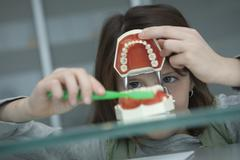 Germany, Bavaria, Landsberg, Girl (8-9) in dental surgery Stock Photos