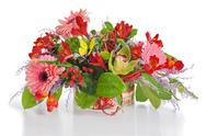 Stock Photo of colorful floral arrangement from lilies, cloves and orchids in cardboard ches