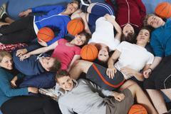 Stock Photo of Germany, Berlin, People lying in gym, portrait