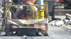 Welder welding metal iron tram rail at Roadworks Stock Footage