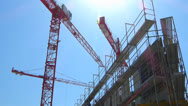 Stock Video Footage of Construction giant crane moving in the blue sky