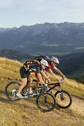 austria, tirol, couple riding bicycle - stock photo