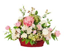 Colorful floral bouquet from roses and cloves arrangement centerpiece in vase Stock Photos